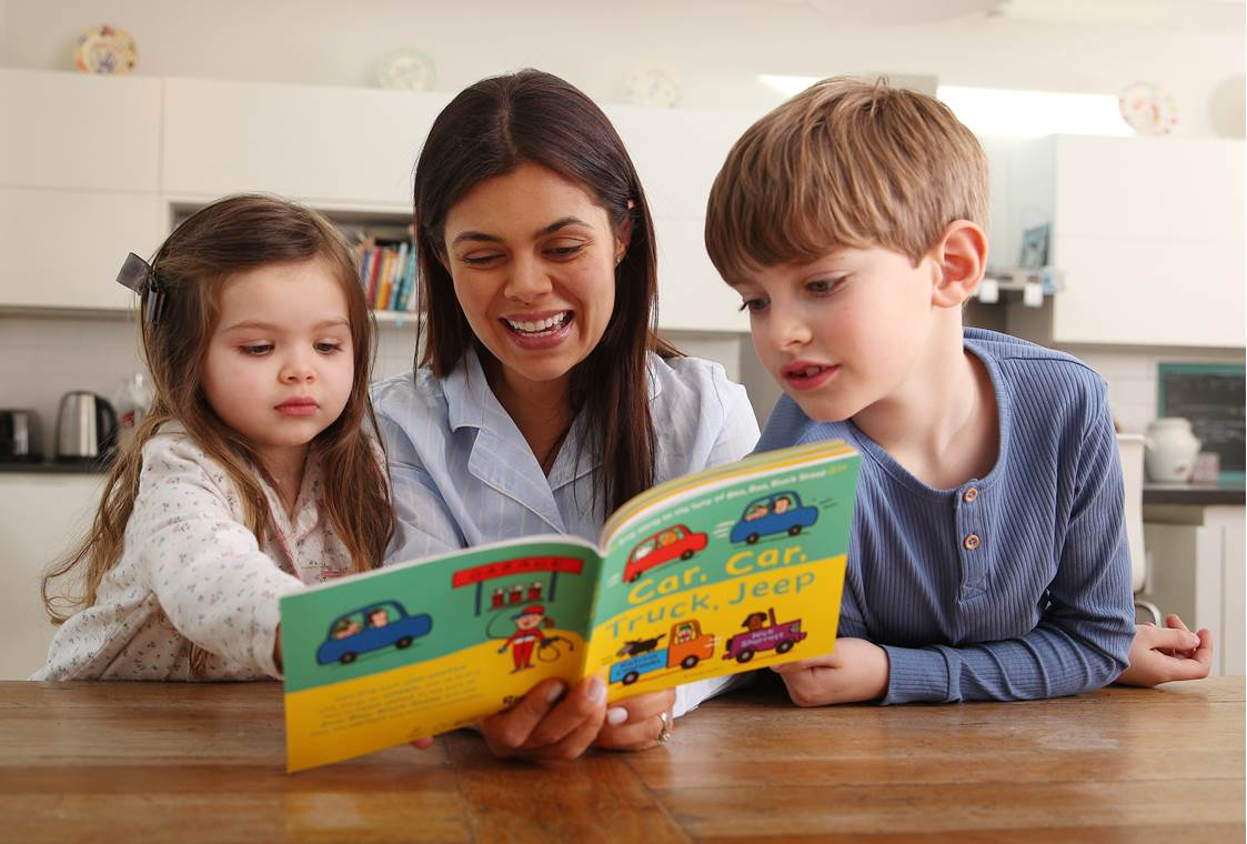 Mother and children reading their Pyjamarama book together