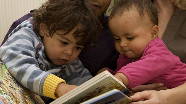 Babies reading together