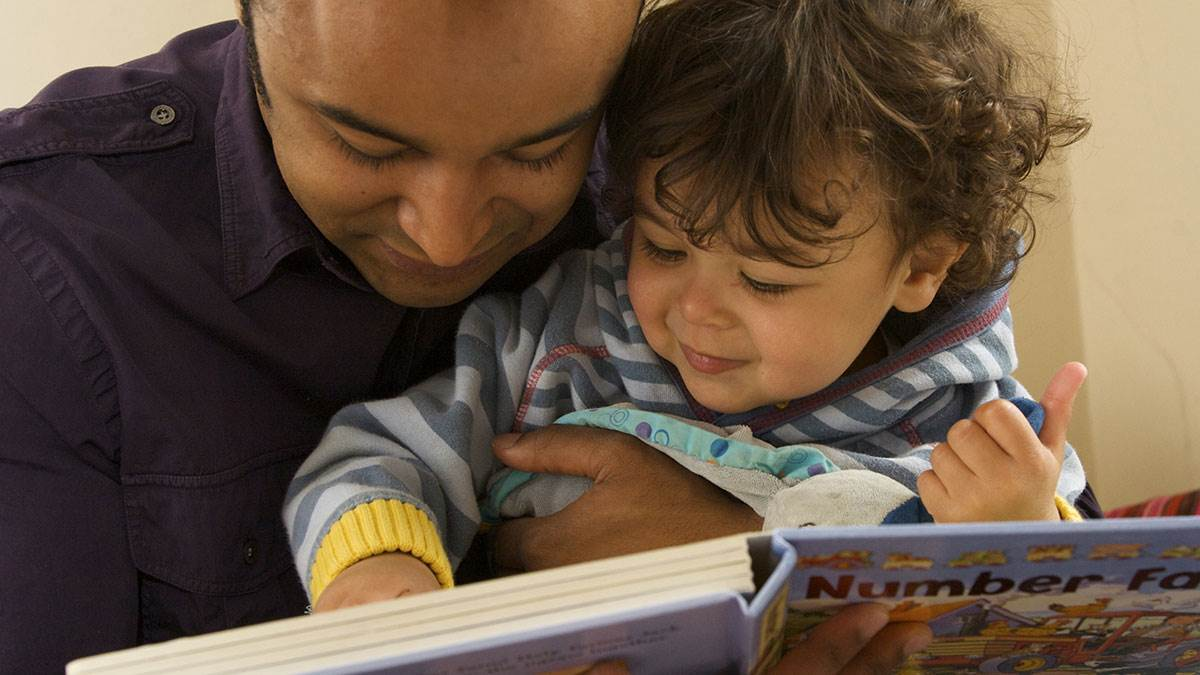 A father and son share a book about numbers