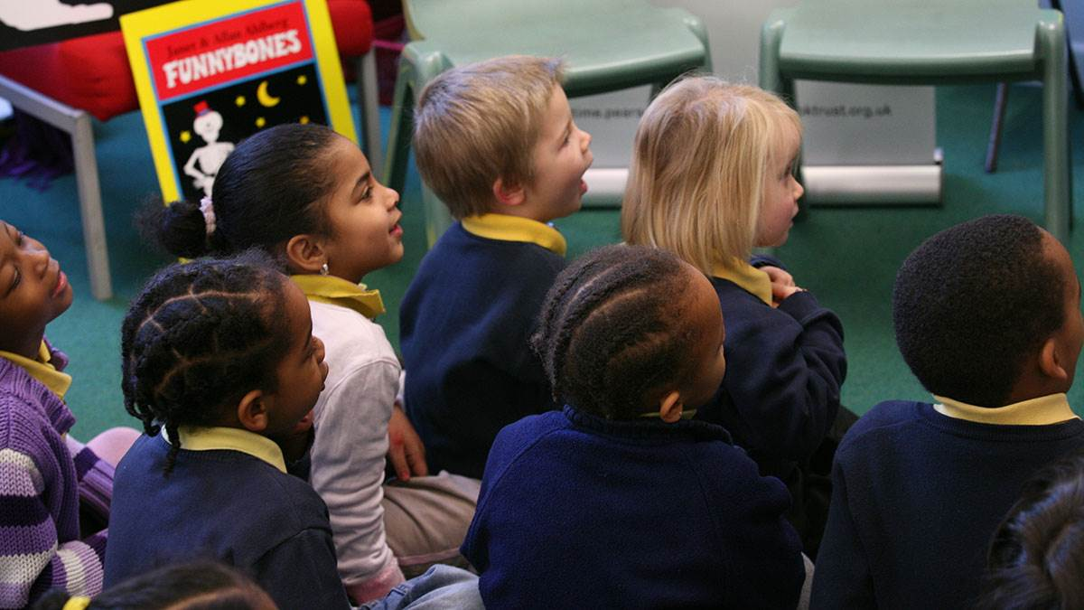School children enjoy being read to