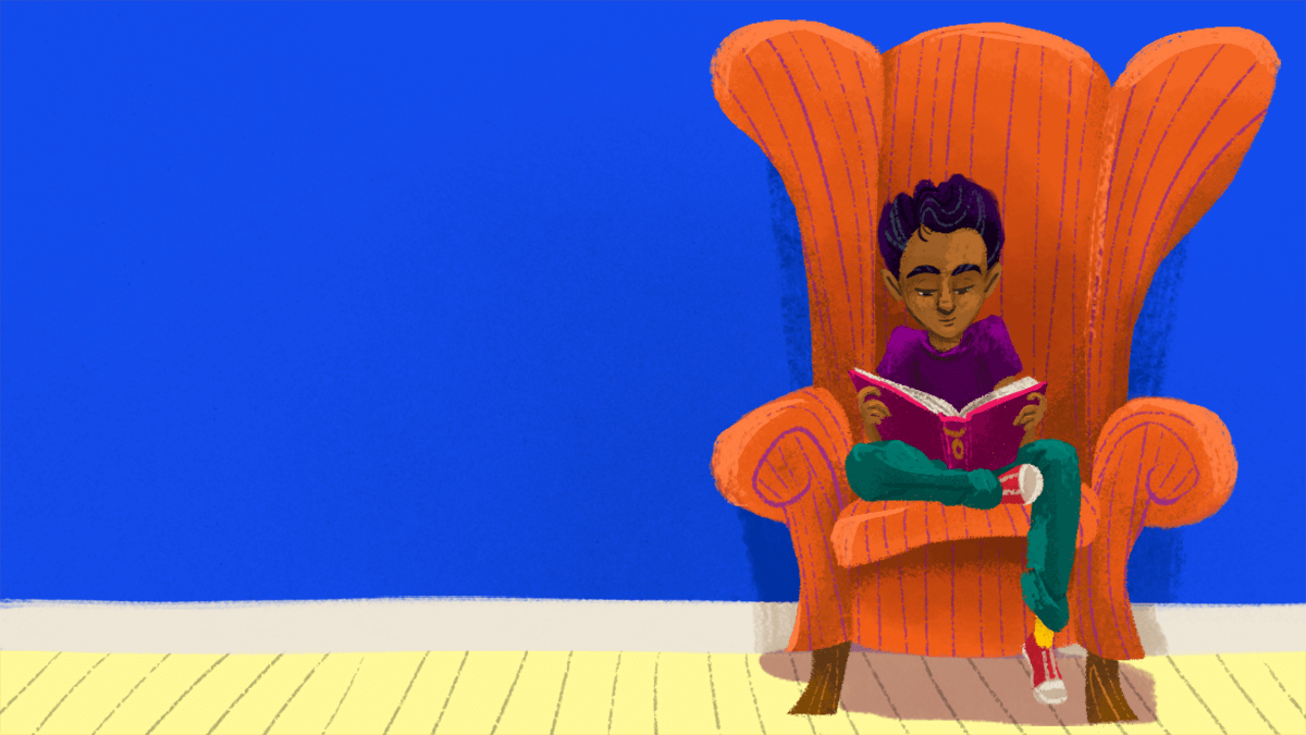 A boy reading in a chair