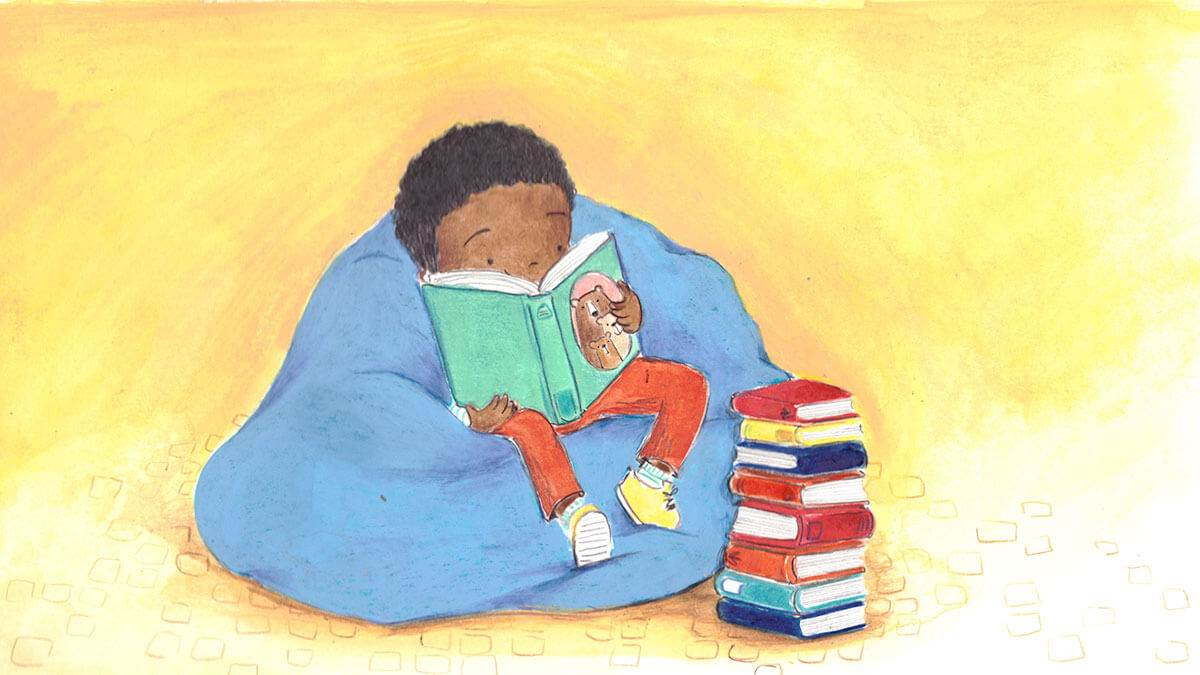 A boy sitting in a beanbag reading