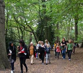 A guided walk in Queen's Wood where Red Leaves is set.