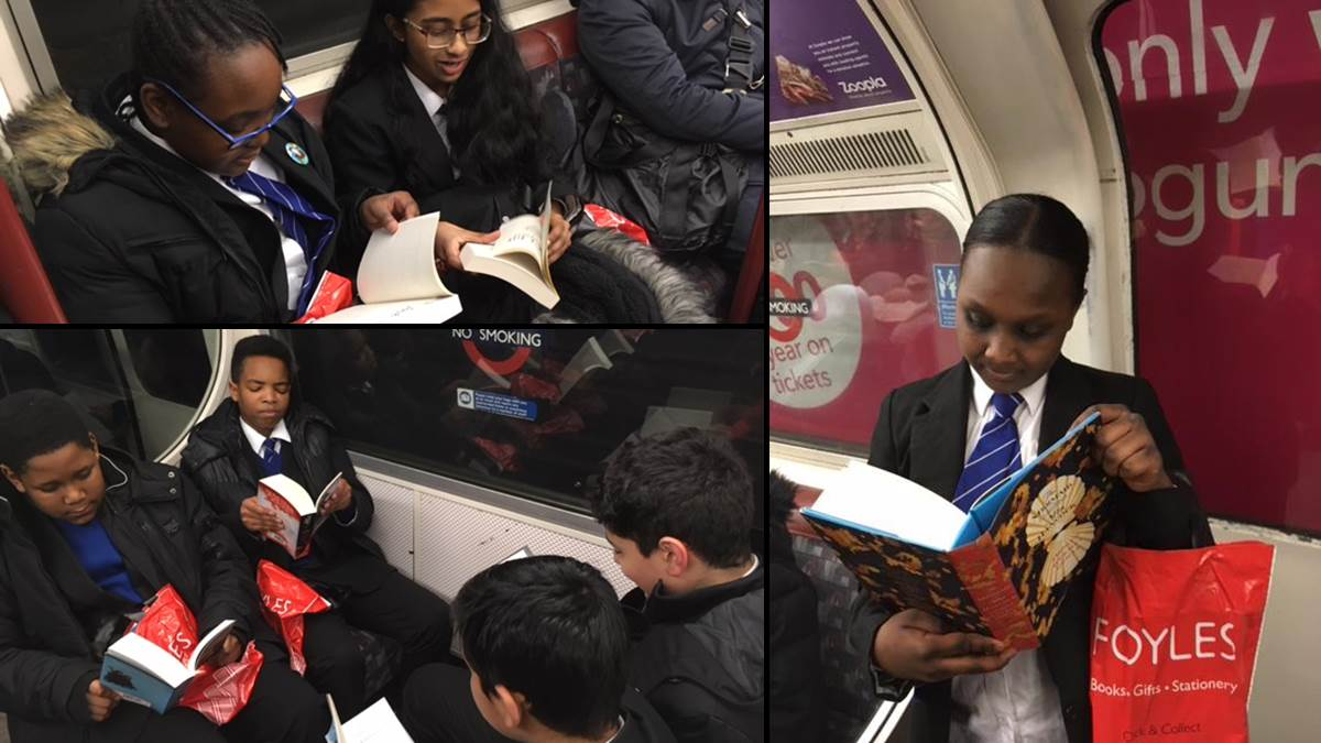 St Augustine's students reading on the London Underground