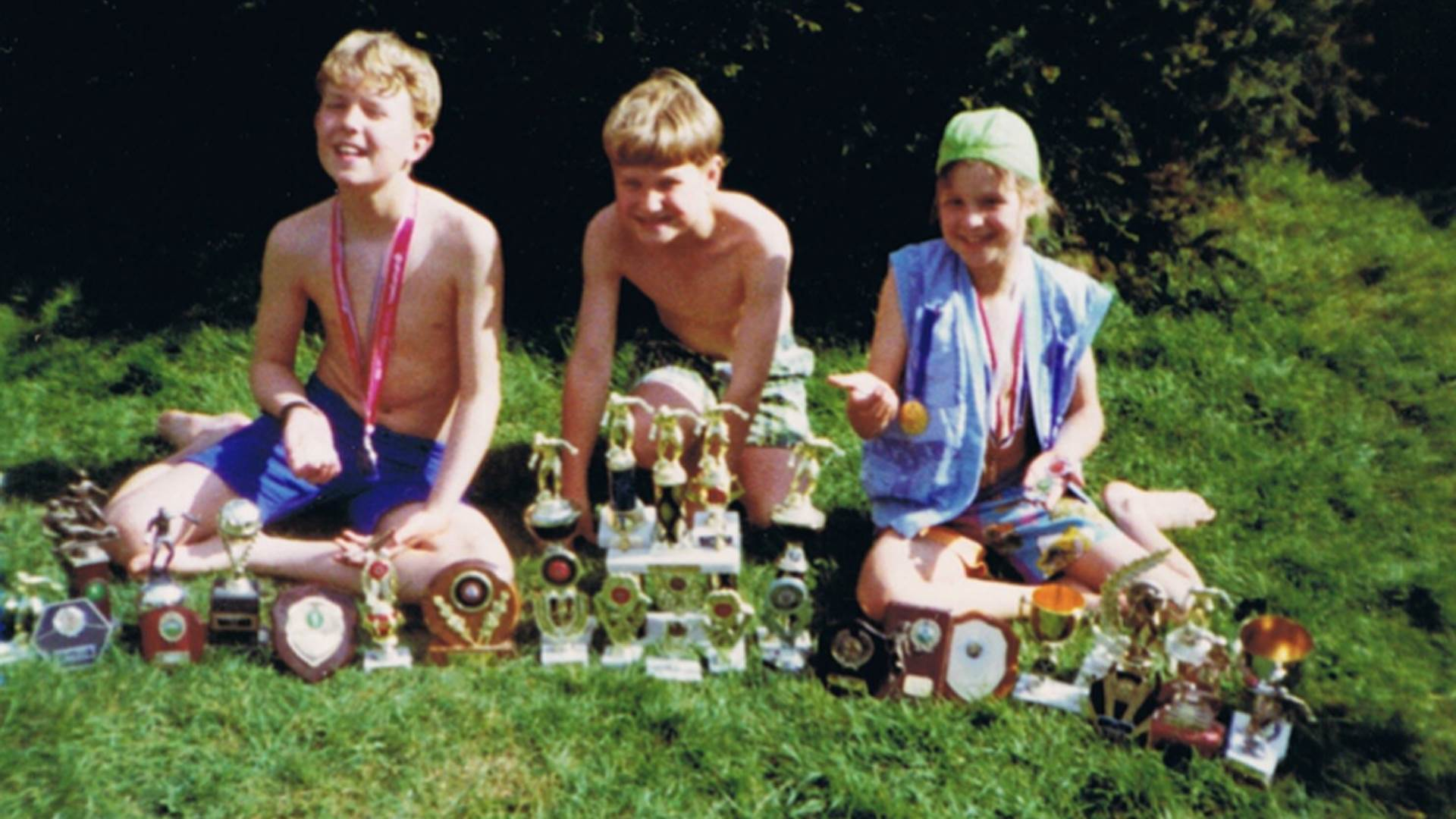 Anna McNuff and her brothers showing off their football trophies as children