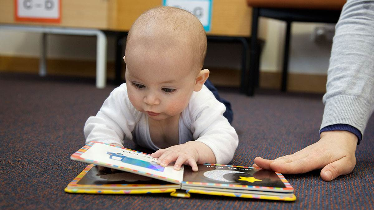Baby with book at libray