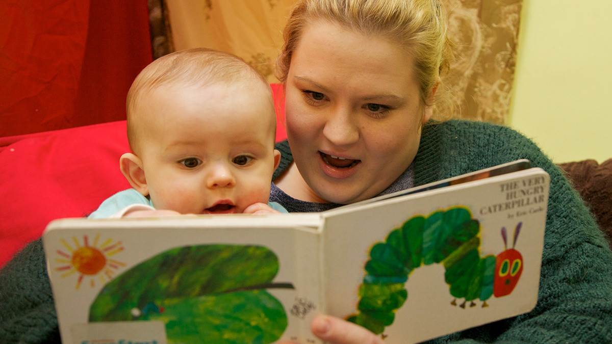 baby and mum reading Hungry Caterpillar