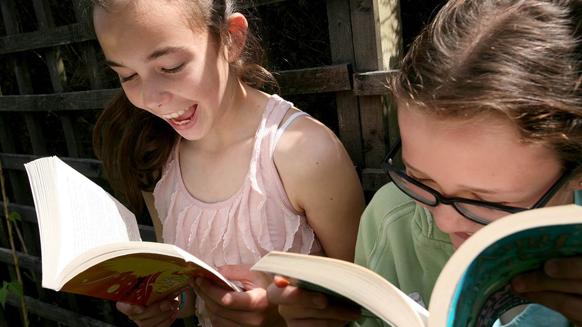 Girls reading in summer