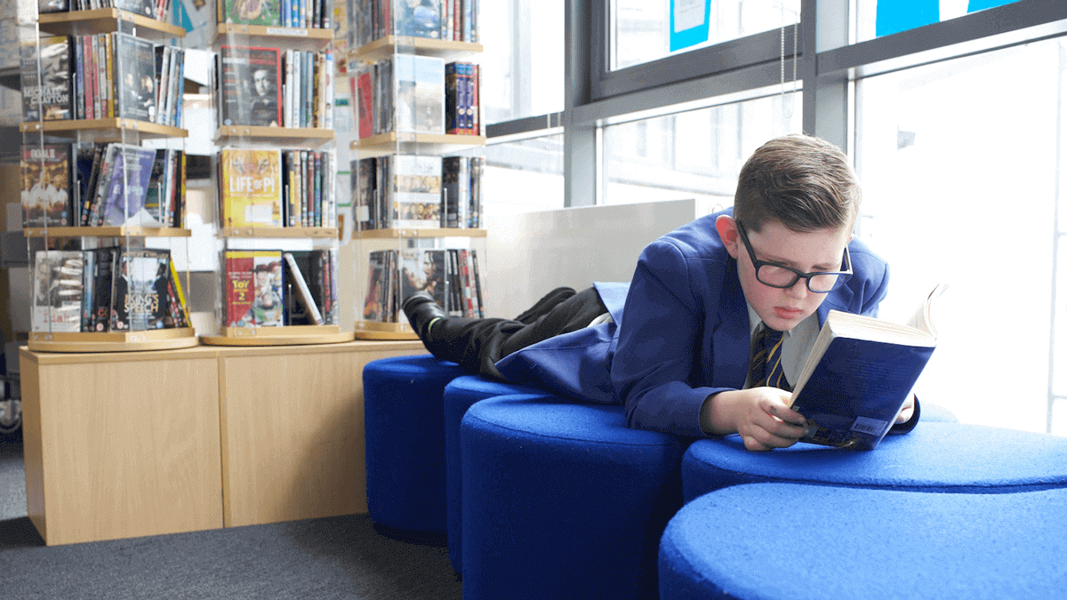 A student reading in their library