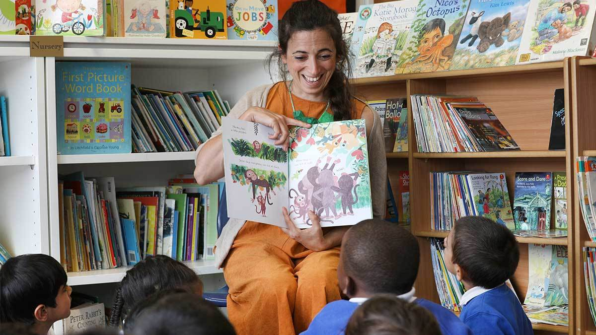 Marta Altes reading Little Monkey to school children